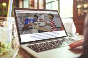 Uplift America website on laptop computer.